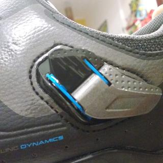 Left shoe with seam on micro-adjust buckle