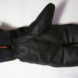 Worn thumb area of glove from handgrips.