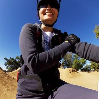 Pumptrack fun with her Troy Lee!