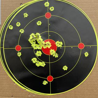 25 yards with and without the red dot. Everything in the center is with the red dot.