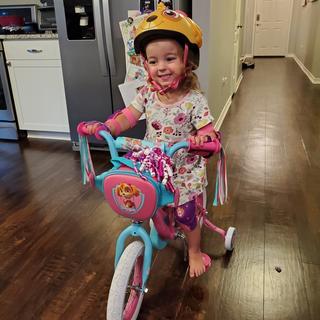 Loving her new bike and matching helmet