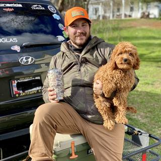 Just a man and his fun dog in training