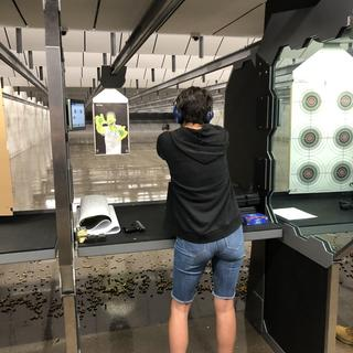 Me at the range with my new pistol