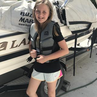 Fits our 12 year old perfectly and is very comfortable.  Great for tubing, skiing and swimming.