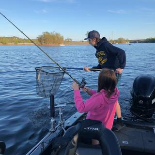 kids using the Scheels rod and reel combo.