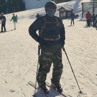 Wearing my Simms SunGaiter while snow skiing at Breckenridge Ski Resort.
