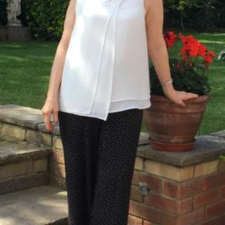 Works well with neutrals, this is the double layered top in ivory