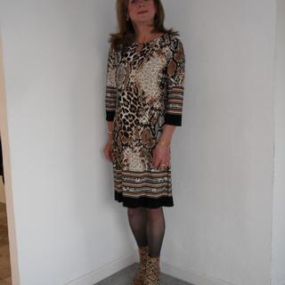 With snakeskin boots