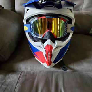 Goggles not included. No lift at all with the visor at high speed.