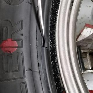Tire dismounted from rim to reveal defect. Would not maintain air pressure.