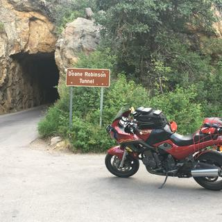End of Iron Mt. Road 17 m, 314 curves, 14 switchbacks, 3 pigtails, 3 tunnels, 2 splits, 4 presidents