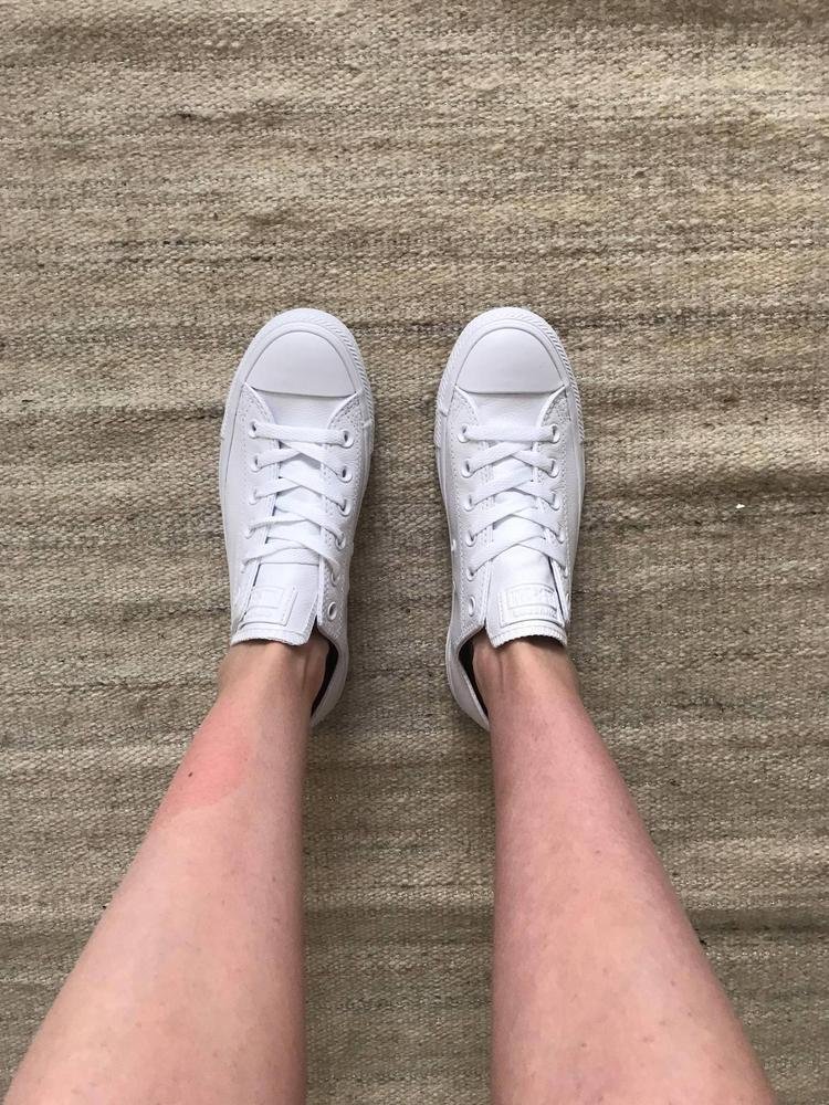 I was so excited for this shoe to arrive. Runs true to size. I rated the comfort average just because I can tell the shoe will take a bit of breaking in which I expected because it's like the classic Chuck Taylors, but made of leather. I'm trying to keep them super clean so I'm treating them with a protectant that I think will keep them looking very nice over time! Love that Converse and Nike are offering this monochromatic style - a sleek take on a classic style! Love! These sneakers were gifted from Converse in exchange for an honest review.