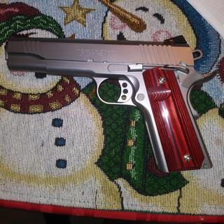 I love it. I put these cherry wood grips on it & it looks great.