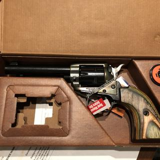 Heritage .22LR & .22Mag single action revolver w/laminate grips and petina housing.