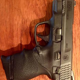 Shield .45 with Hogue sleeve and extended mag grip and full Apex trigger system