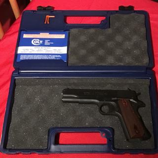 Government Colt in its case.
