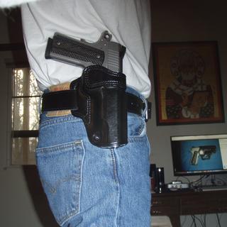R1S in it's Galco Avenger holster.