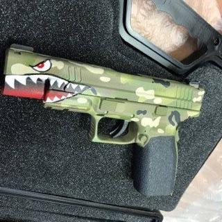 XD Tactical .45 multi-cam camo, tungsten filled guide rod, partial trigger job.