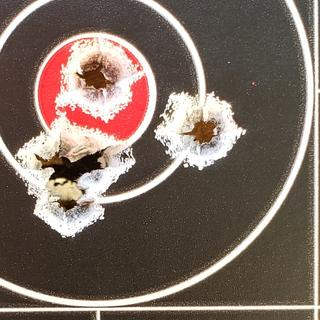 100 yard second 5 shot group in 25 mph winds with gusts into the 30's.
