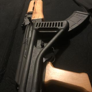 Swapped out my stock for a tapco side folding stock, switched my grip with a wooden one too.