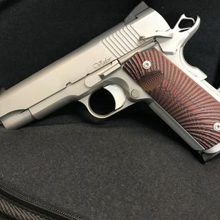 With new grips and magwell.   She is a beauty.