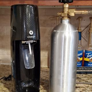 The tank is obviously too large to fit inside the SodaStream.