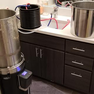 Counter flow wort chiller hooked up to sink for chilling