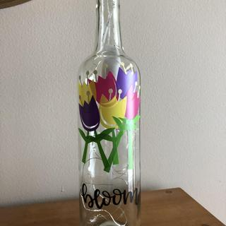Lights off.  Fun craft to make and gift.  Love the bottles.