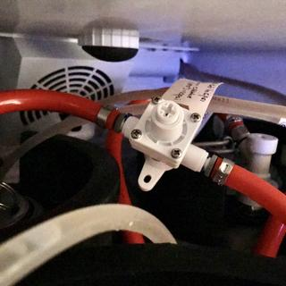 Regulator in use with barbed John Guest fittings to connect it to the CO2 line