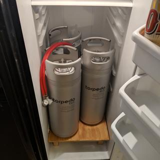 Can slide each keg out without moving the other