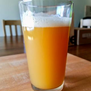 Very hazy. Looks like a glass of orange juice.