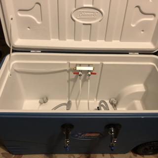 Dual tap cooler for 2 small kegs.