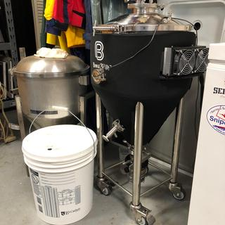 New school, shiny X1, older stainless conical and the oldest school plastic bucket.
