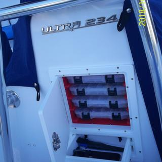 4 trays and drawer installed in console of 23-ft Sea Hunt 234.