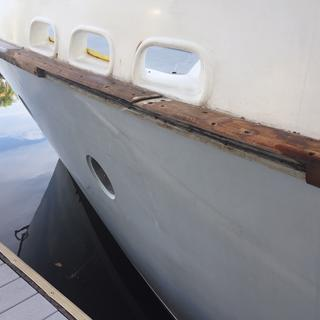 Side rail damage that occurred in boatyard.