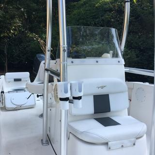 Perfect for our boat. So easy to install on Ttop frame. Shape of holder does limit what it holds .