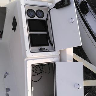 Custom hinged starboard doors will protect expensive electronics from theft and from sun damage.