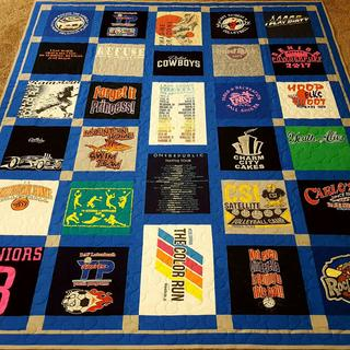 Quilt made out of T-shirts with minky on the back side. The quilt turned out very snuggly & warm.