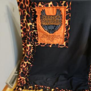 This is what I did with the flame fabric. Beautiful Harley Davidson personalized blanket.