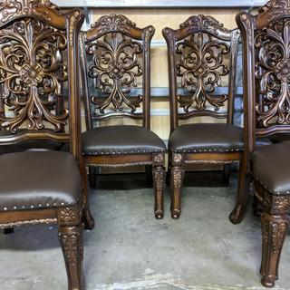 These chairs were reupholstered in the Nassimi Sprit Expresso Vynil fabric, they look awesome.