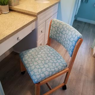 My beach themed bathroom came together beautifully with my reupholstered vanity chair. Love it!