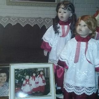 Mama's Christmas dolls. The gowns made of cranberry satin  with Chantilly lace over them.