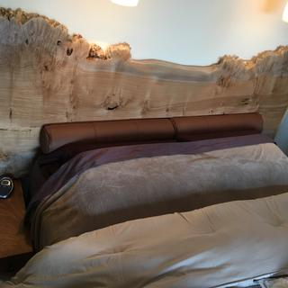 Finished bolster in leather against new headboard.