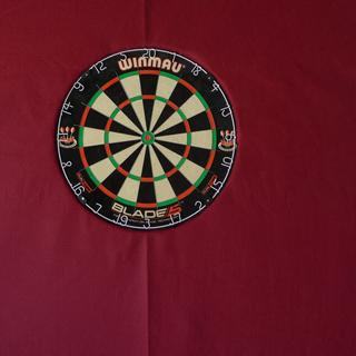 Used my fabric to make my back board for my dart board look nice.