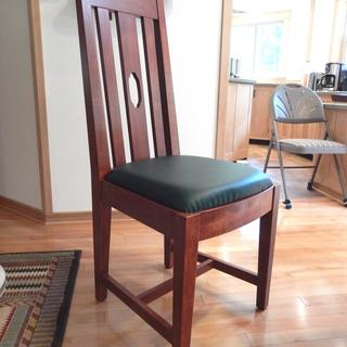 Dining room chair with foam seat.