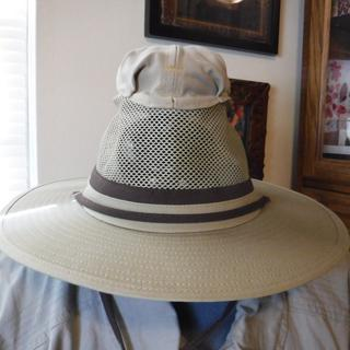 Hat with attached No-see-Um netting packed in sewn-on zip pocket.