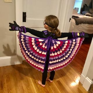 So happy with her Falcon Wings! Back view.  Fuchsia and Purple felt from Online Fabric Store.