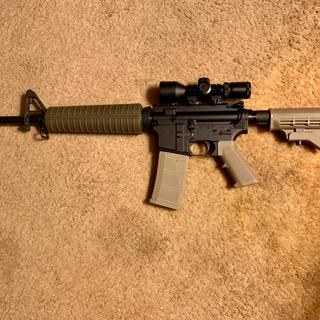 With a neat little super compact 3-9x42mm illuminated scope. Hard to reach the charging handle.