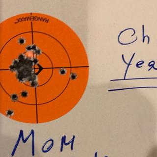 And here is her 3 inch target at 25 yards. And she tells me she's not quite dialed in yet..