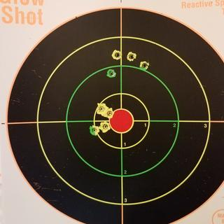 90 grain Federal Match at 100 yards.  First and second four shots (after a minor adjustment).